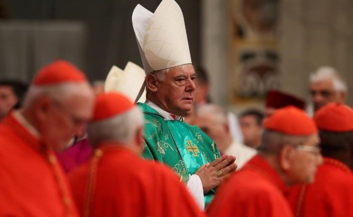 Newly elected cardinal Gerhard Ludwig Muller of Germany arrives during a consistory ceremony led by Pope Francis in Saint Peter's Basilica at the Vatican February 22, 2014.