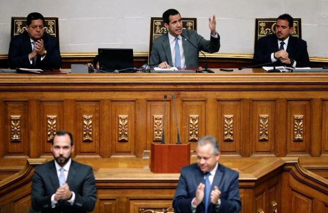 Venezuelan opposition leader Juan Guaido, who many nations have recognized as the country's rightful interim ruler, attends a session of Venezuela's National Assembly.