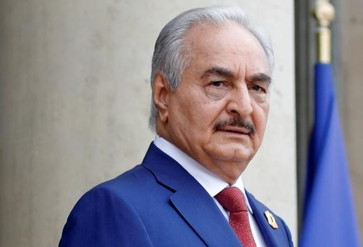 Khalifa Haftar, the military commander who dominates eastern Libya, arrives to attend an international conference.