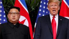 US President Donald Trump and North Korean leader Kim Jong Un react at the Capella Hotel on Sentosa island in Singapore.