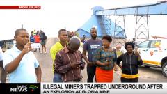 Community members waiting outside the mine