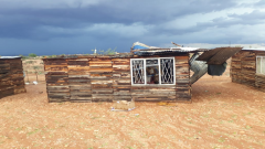 A shack with a damaged roof