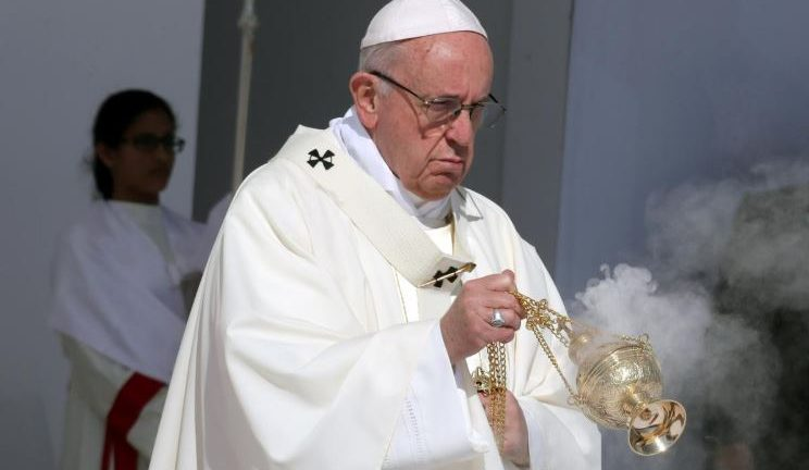Pope Francis holds a mass at Zayed Sports City Stadium in Abu Dhabi, United Arab Emirates.