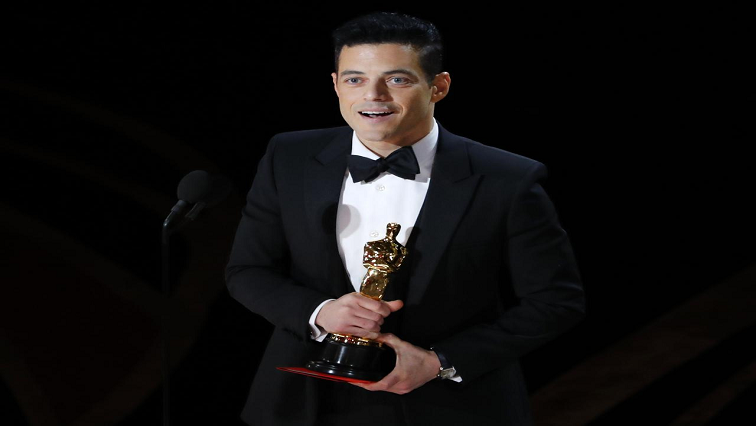 Rami Malek holding his Oscar
