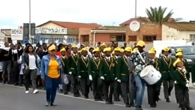 People marching in uniform