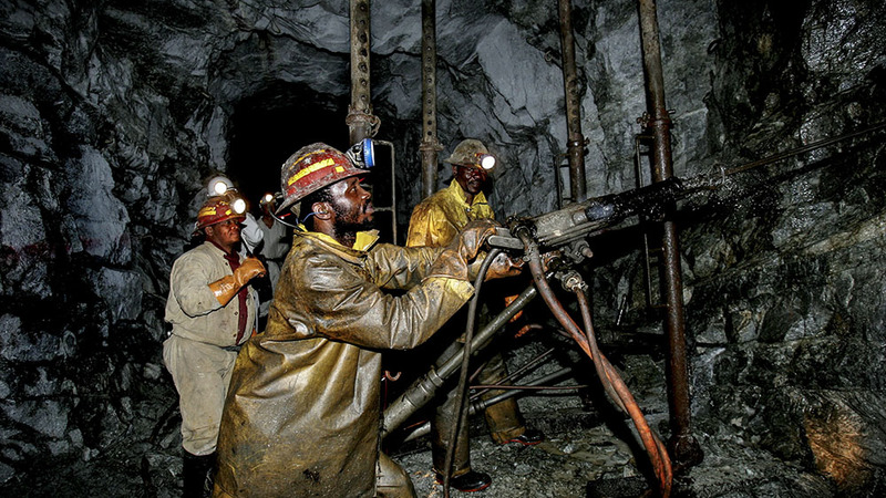 Miners in a mine shaft
