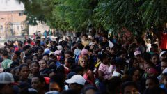 "Venezuelans line up as they wait for a free lunch at the ""Divina Providencia"" migrant shelter outskirts of Cucuta."