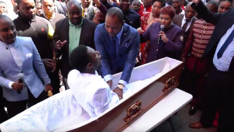 A person in a coffin