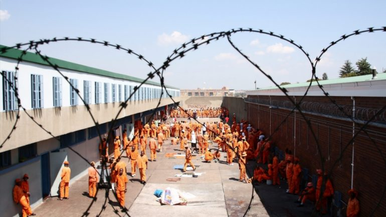 Prisoners in prison courtyard