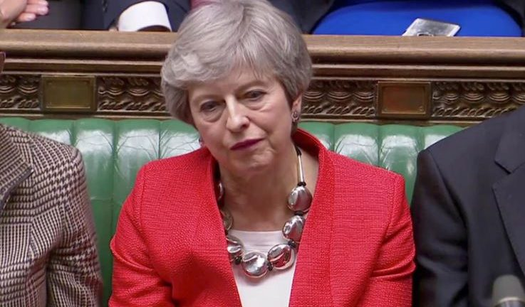 British Prime Minister Theresa May reacts after tellers announced the results of the vote Brexit deal in Parliament in London.