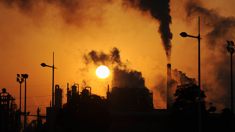 Smoke from factories pollute the air.