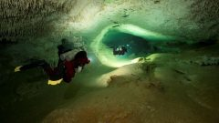 Inside the cave which is underground