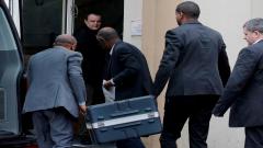 Men carrying a black case