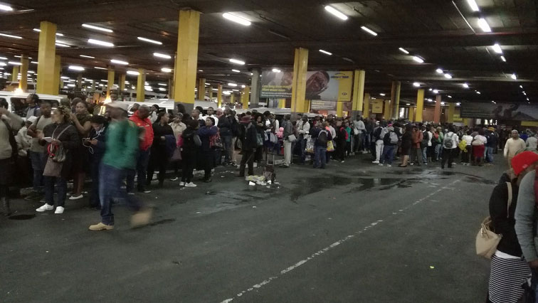 Taxi commuters at a taxi rank