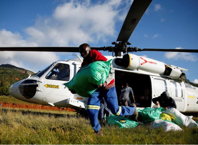 Aid workers scramble to get supplies to cyclone Idai victims