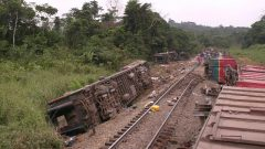 Overturned carriages lie near the rail track in Yanga, Congo-Brazzaville, after seventy-six people were killed in Monday's rail disaster. The Congo-Brazzaville government on Tuesday issued a provisional toll of 48 dead and more than 400 injured in the accident, and said the search for more bodies would continue.