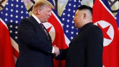 President Donald Trump and North Korean leader Kim Jong Un shake hands before their one-on-one chat.