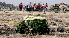 Members of the Ethiopian red cross search for remains at the Ethiopian Airlines Flight ET 302 plane crash before a commemoration ceremony at the scene of the crash, near the town of Bishoftu, southeast of Addis Ababa.