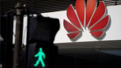 A Huawei company logo is seen outside a shopping mall in Shanghai, China