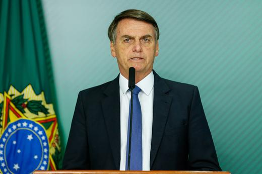 Brazil's President Jair Bolsonaro gives a statement at the Planalto Palace, in Brasilia.