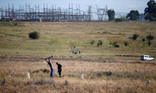 Man is seen digging to mark vacant land in Olievenhoutbosch near Centurion