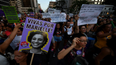 Demonsrators carrying pictures of Marielle Franco