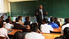 A teacher in front of learners