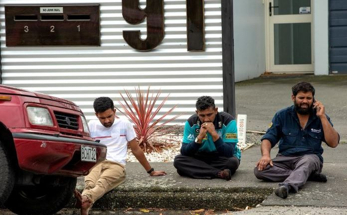 Grieving members of the public following a shooting at the Al Noor mosque in Christchurch, New Zealand.