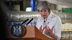 British Prime Minister Theresa May delivers a speech during a visit to the Portmeirion factory in Stoke-on-Trent, Britain.
