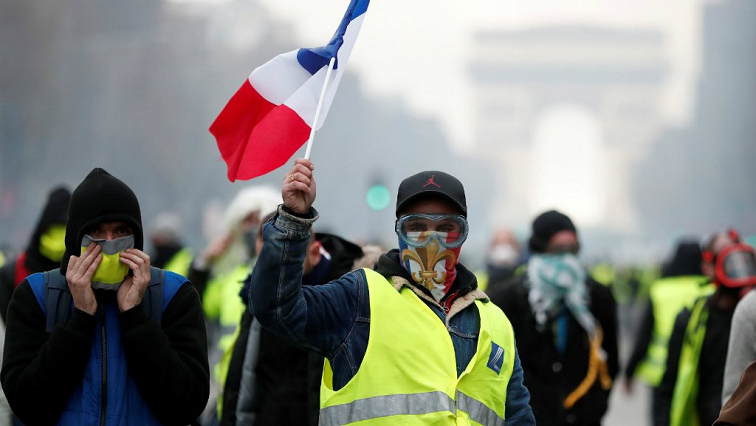 Yellow vest protester holding French flag