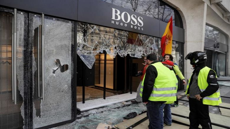 Protesters near damaged Boss window