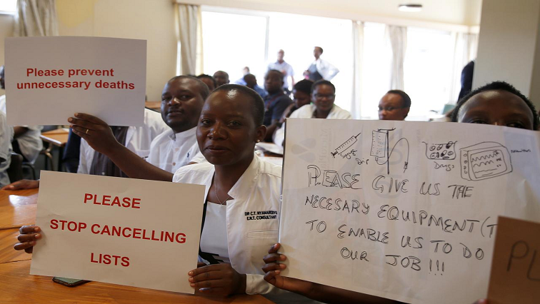 Doctors holding placards.