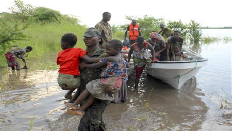 People in a boat escaping floodwaters