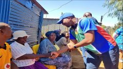 Mmusi Maimane greeting some of the residents.