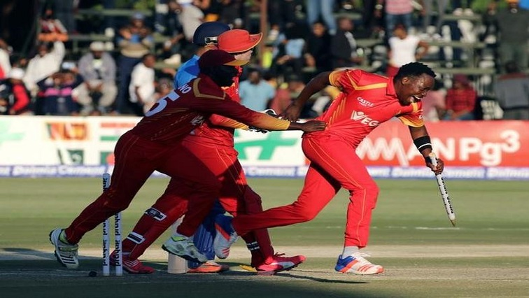 Zimbabwe players celebrate after their T20 cricket victory against India