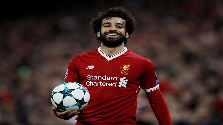 Mohamed Salah holding a ball