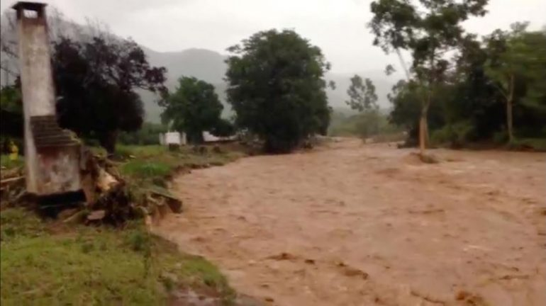 Flooding caused by Cyclone Idai is seen in Chipinge, Zimbabwe, March 16, 2019 in this still image taken from social media video obtained March 17, 2019.