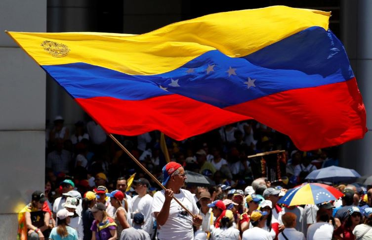 Supporters of Venezuelan opposition leader Juan Guaido, who many nations have recognized as the country's rightful interim ruler, take part in a rally against Venezuelan President Nicolas Maduro's government in Caracas.