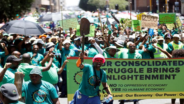 AMCU members chant slogans during a march to the Minerals Council of South Africa in Johannesburg