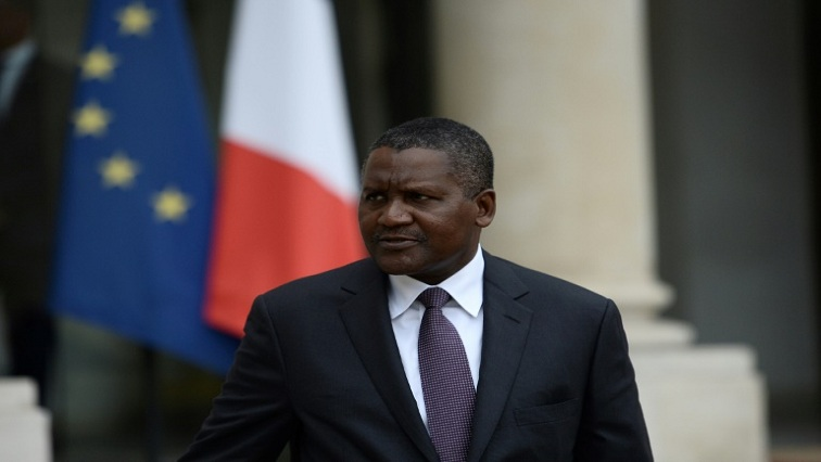 SABC News Aliko Dangote AFP - Africa's richest man withdrew $10 million just to look at it