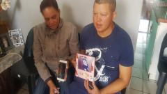 Alvineesha Brookes's parents holding her photo