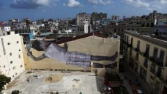 A giant photograph of a boy by French photographer and artist JR is seen on a wall, during the 13th Havana Biennial, in Havana, Cuba.
