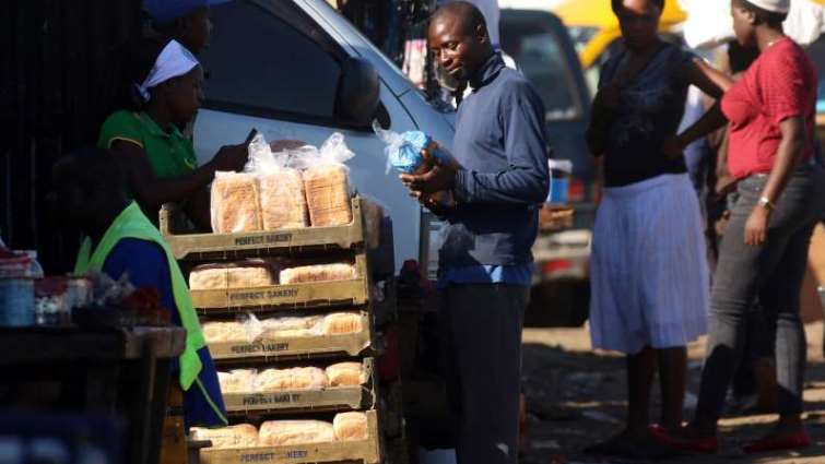 SABC News Bread in Zim Reuters - Zimbabwe nearly doubles bread price as economic woes mount