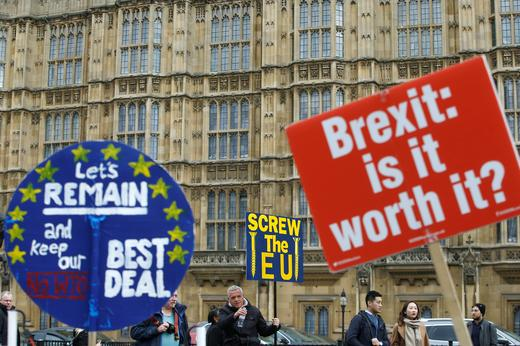 Pro-Brexit and anti-Brexit protesters are pictured outside the Houses of Parliament in London.