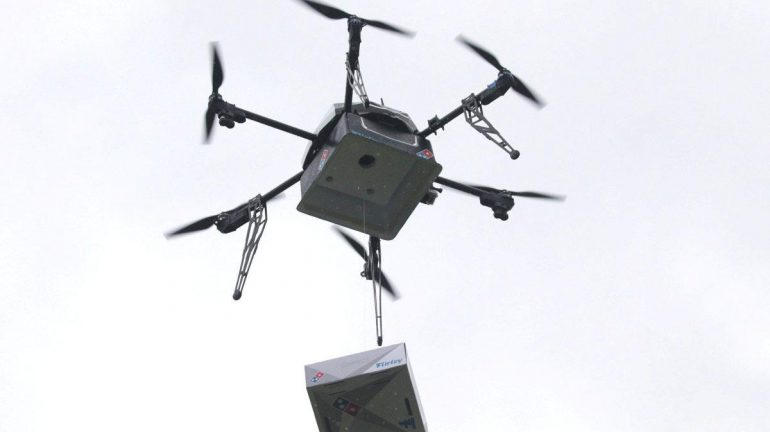 A delivery drone performs a test flight with a Domino's pizza box in Auckland, New Zealand.