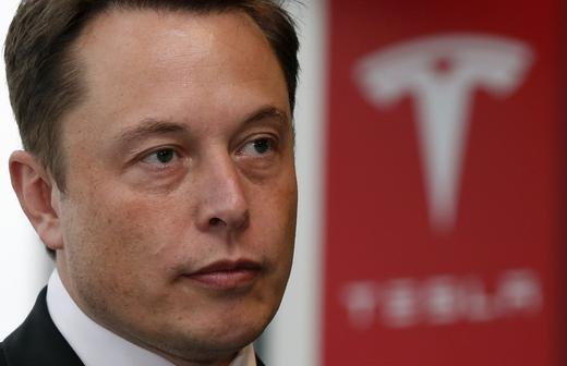 Tesla Motors Inc Chief Executive Elon Musk pauses during a news conference in Tokyo.