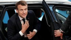 French President Emmanuel Macron arrives at a European Union emergency summit on Brexit in Brussels.