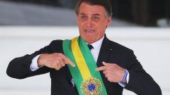 Brazil's new President Jair Bolsonaro gestures after receiving the presidential sash from outgoing President Michel Temer.