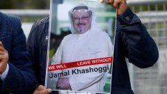 A demonstrator holds picture of Saudi journalist Jamal Khashoggi