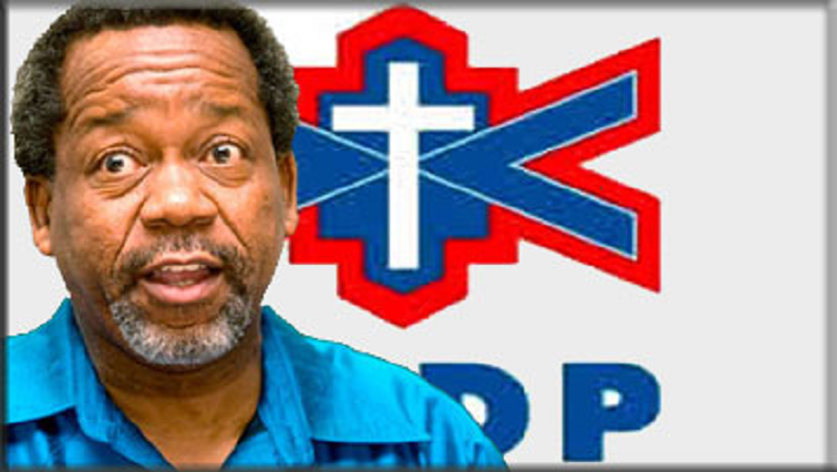 Reverend Kenneth Meshoe in front of ACDP logo